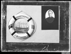 Life belt with a mounted photograph of Captain Ray Milton Sterling