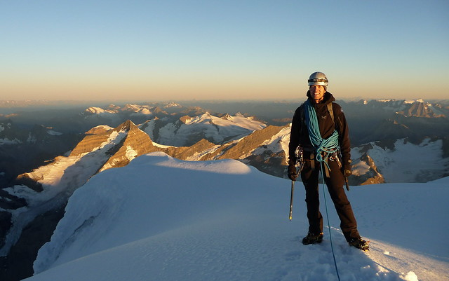 Conrad on the summit of Mt Robson at sunrise