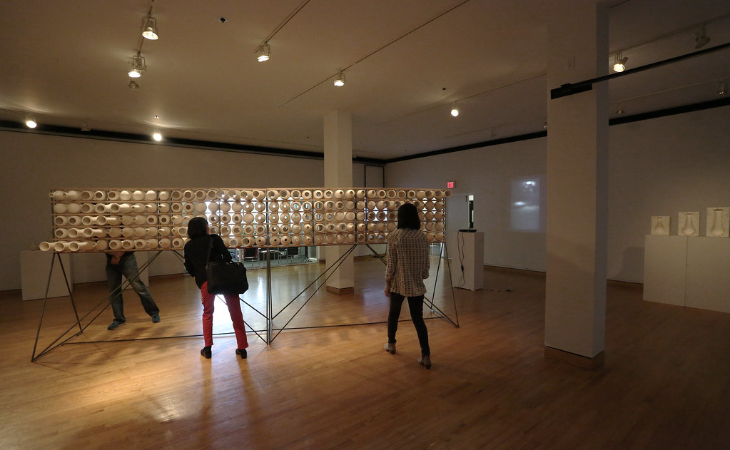 A view showing visitors engaging the interactive wall.