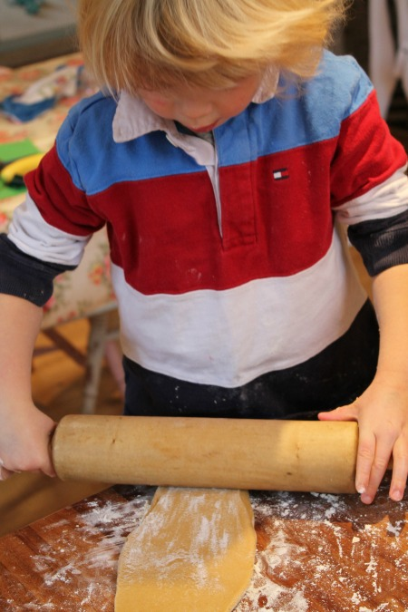toddler cooking with rolling pin