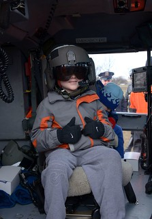 NEW YORK - A Coast Guard Air Station Atlantic City helicopter crew helped fulfill the dream of a Queens boy at Juniper Valley Park in Queens, N.Y., March 24, 2014.Eight-year-old Colin Flood, diagnosed with acute lymphocytic leukemia, is battling his second round of the disease after fighting it off with chemotherapy and a bone marrow transplant. An avid fan of shows such as Coast Guard Alaska and the Deadliest Catch, Colin dreamed of being in a Coast Guard helicopter. Due to the serious nature of his condition, Colin could not travel. The NYPD and FDNY closed Juniper Valley Park, located near the Flood's home, so a helicopter could safely land there and Colin could visit it. U.S. Coast Guard photo by Petty Officer 2nd Class Jetta H. Disco.