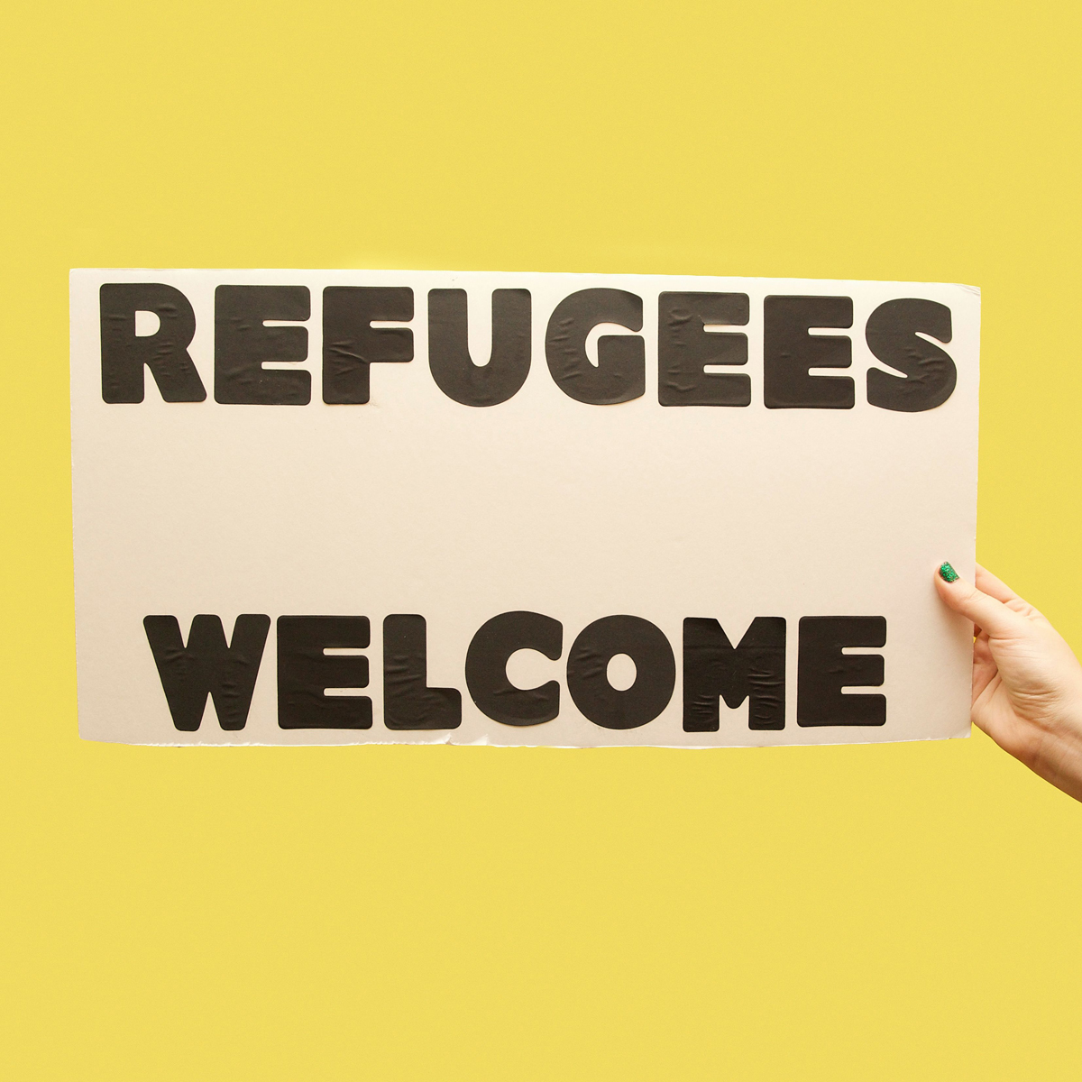 45 Protest Signs_Brandon and Olivia Locher_29_RefugeesWelcome