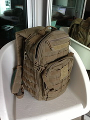 handbag(0.0), car seat(0.0), bag(1.0), furniture(1.0), brown(1.0), military(1.0), backpack(1.0),
