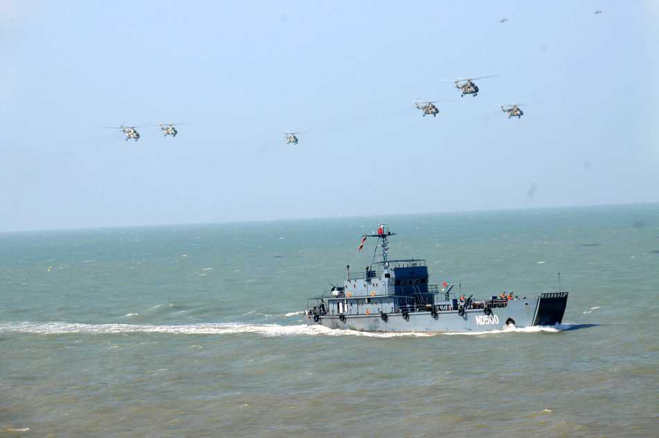 9867175214_e2a91a618e_b - China conducts massive 'island reclamation' military exercise - Talk of the Town