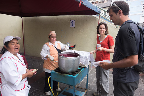 Colada morada and guaguas de pan from a street vendor | Day of the Dead in Ecuador
