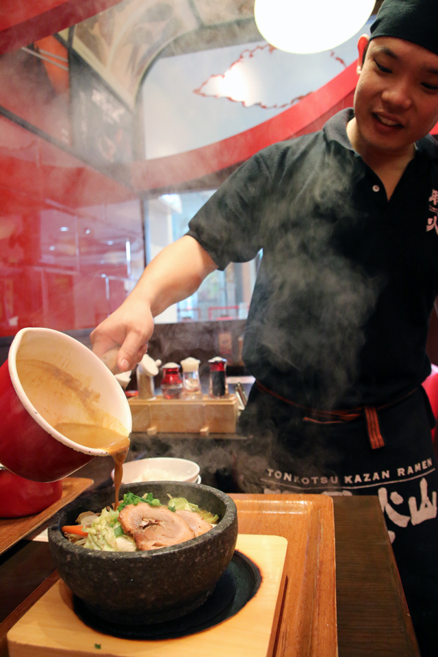 Adding the soup to the ramen