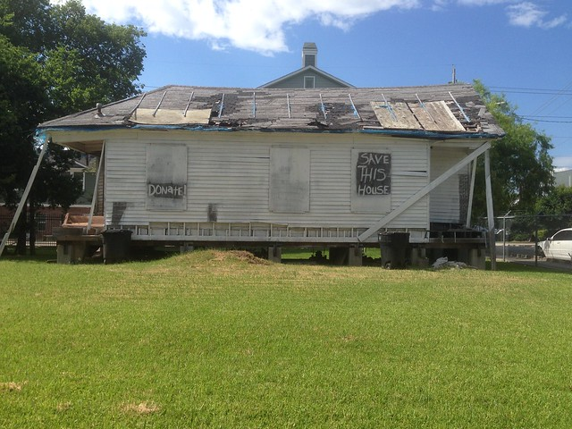 A traditional shotgun style house fallen into disrepair