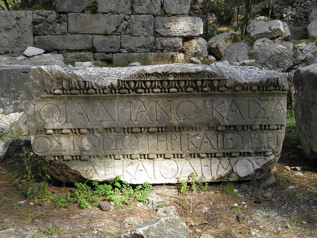 Dedicatory inscription of Hadrian carved in three lines onto the architrave at the top of Hadrian's arch, Phaselis, Lycia, Turkey