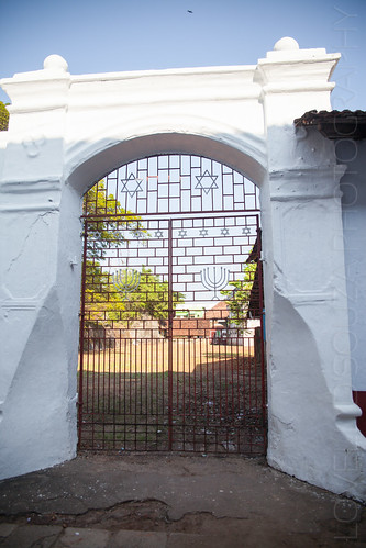 An open area barred to outsiders by an iron gate with Star of David patterns