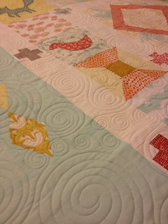 close up of quilting on penny sampler