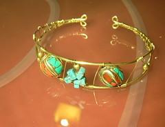 clothing(0.0), tiara(0.0), orange(1.0), yellow(1.0), jewellery(1.0), bangle(1.0), headpiece(1.0), circle(1.0), bracelet(1.0),