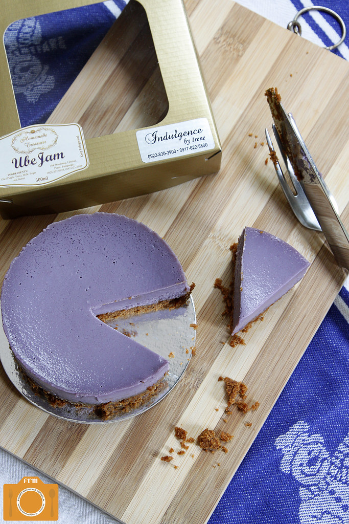 Indulgence by Irene Ube Cheesecake on bamboo cutting board