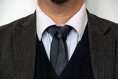 groom(0.0), sleeve(0.0), tuxedo(0.0), pattern(1.0), clothing(1.0), collar(1.0), dress shirt(1.0), male(1.0), man(1.0), outerwear(1.0), formal wear(1.0), suit(1.0), necktie(1.0), gentleman(1.0),