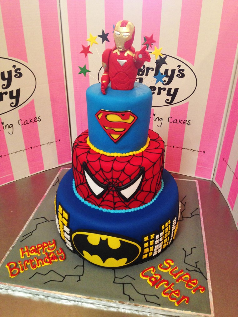 3tier Super hero themed cake with Iron man cake topper a photo