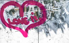 Love is.....a  pink heart on white wall!