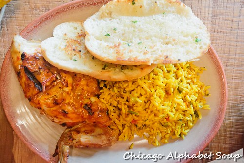 Half Chicken, Portuguese Rice, Garlic Bread