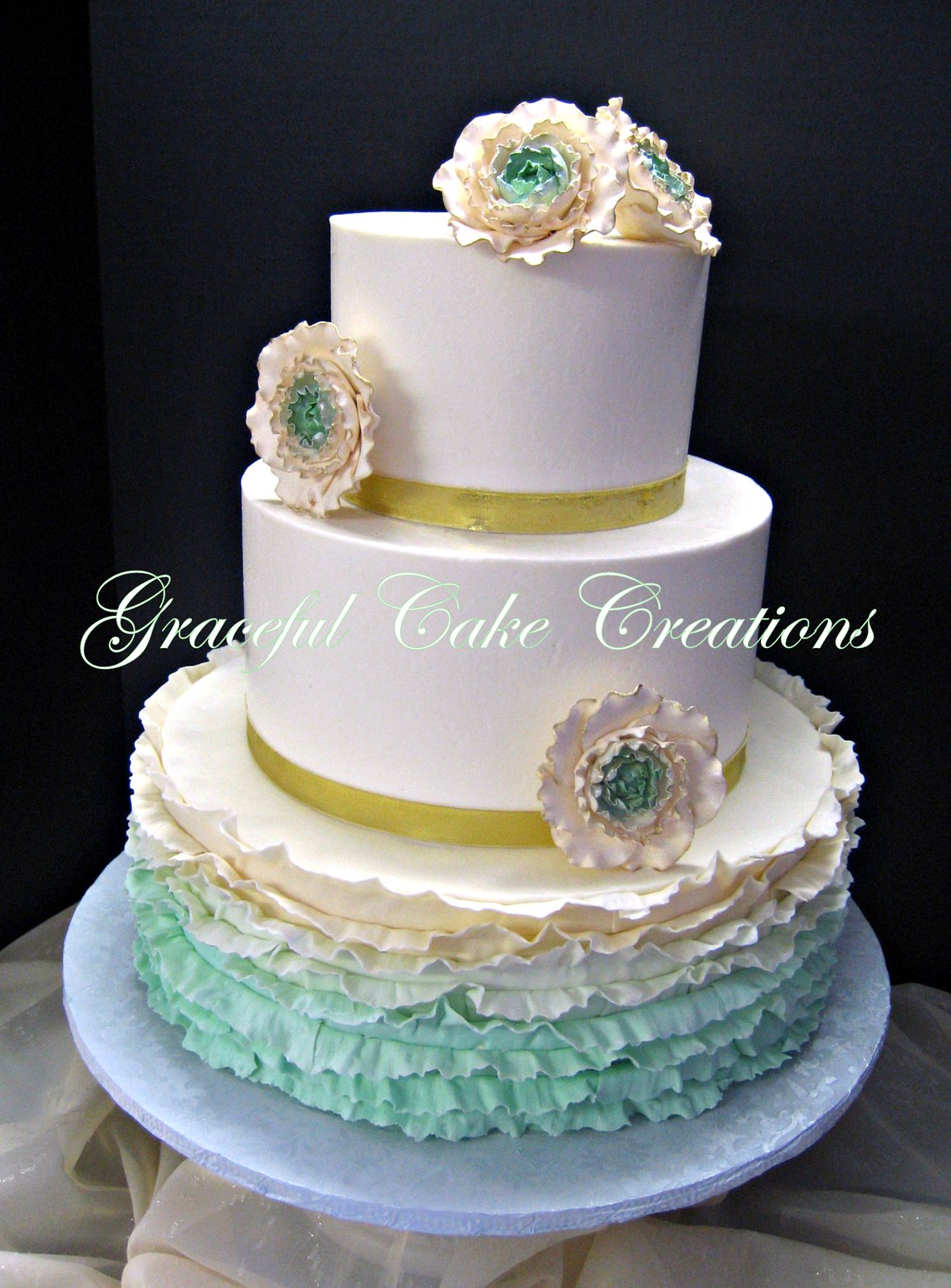 Elegant Ivory Butter Cream Wedding Cake with a Mint Green