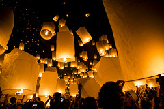 People releasing Khom Loys (Hot Air Lanterns) at the YeePeng Festival in Sansai Thailand 53