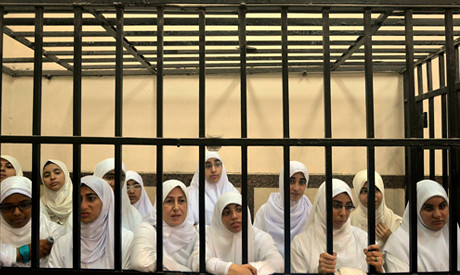 Egyptian women held in prison cage in Alexandria. The military regime gave them 11 year sentences. by Pan-African News Wire File Photos