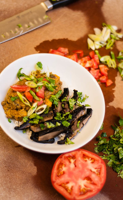 slow cooker sweet potato, lentil and kale curry with marinated grilled portobellos