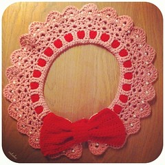 Commissioned large pink crochet collar in organic cotton with large detachable red bow and pearl accents. ♡