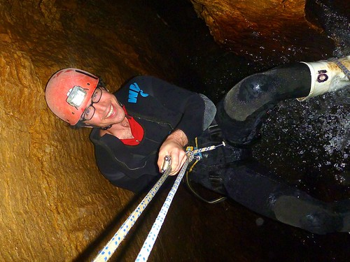 rappelling down a waterfall in a cave at Haggas Honking Holes