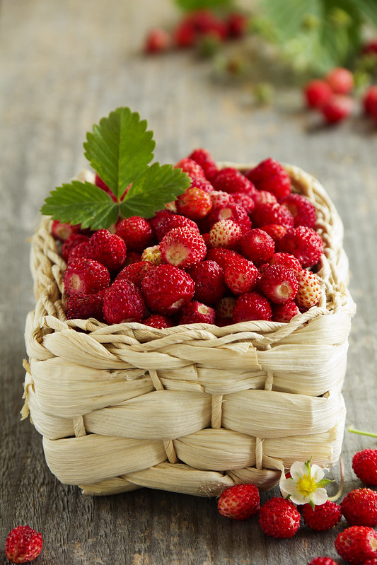 Wild strawberry in a small basket.