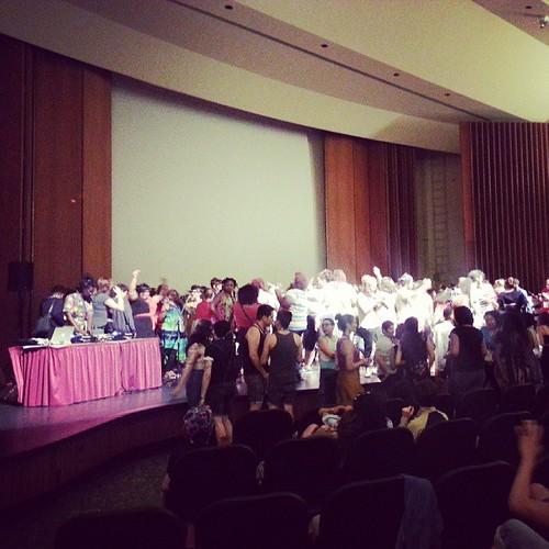 People rush the stage to dance at the #amc2013 opening ceremony on June 21, 2013 <3