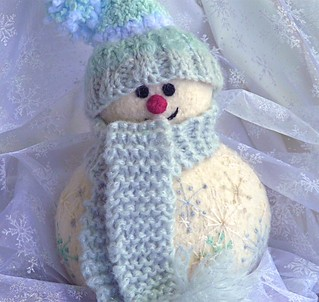 Knitted/felted snowman.  Pattern from Marie Mayhew Designs.