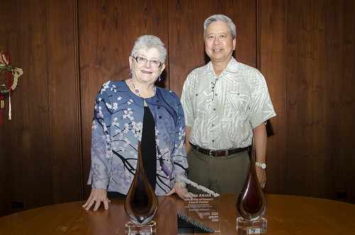 <p>Colin Shimokawa from Shimokawa Nakamura, Inc. presented University of Hawaii President M.R.C. Greenwood with two awards their received for its work on the University of Hawaii Cancer Center. (August 5, 2013)</p>