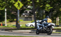A Sailor rides his motorcycle on Joint Base Pearl Harbor-Hickam. (U.S. Navy photo by Mass Communication Specialist 3rd Class Diana Quinlan)