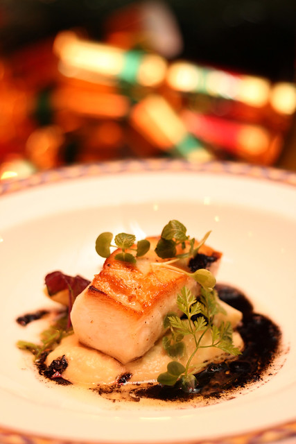 Pan Seared Snow Fish Medallion, Leeks Puree and White Asparagus, Sprouts and Ash Sauce