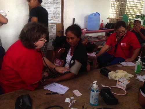 RNRN members at work in evacuation center in Estancia. More than 2,000 have been forced from their homes.