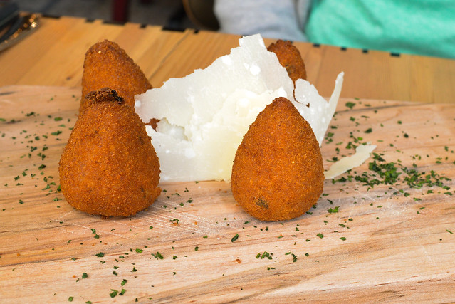 Arancini di Modica deep fried rice cones stuffed with cheese and meat ragu