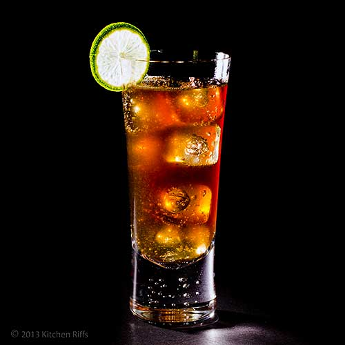 Cuba Libre Cocktail in tall glass with lime garnish