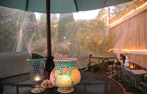 When twilight arrives the lights come on, mosquito netting, patio furniture, lamps, under the umbrella, A Garden for the Buddha, Seattle, Washington, USA by Wonderlane