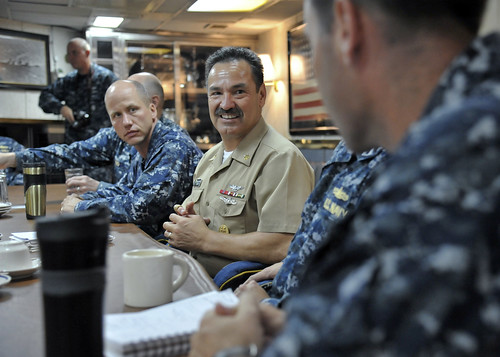 U.S. Pacific Fleet Master Chief Marco Ramirez talks with officers and midshipmen in the wardroom