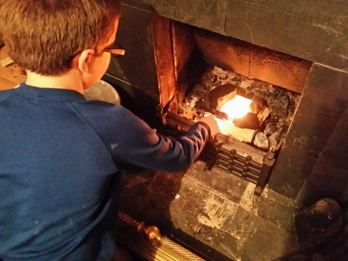 Evan learning to start the fireplace.