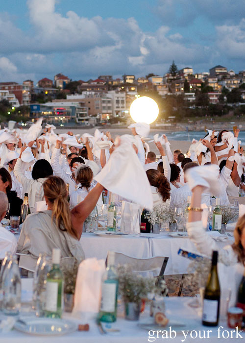Napkin waving at Diner en Blanc Sydney 2013 Bondi Beach