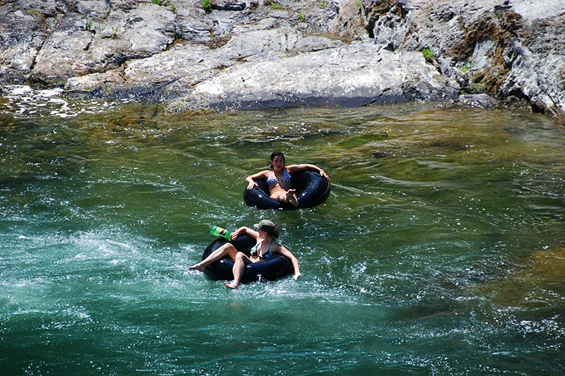 Tubing down the Cowichan River through Cowichan River Park, Cowichan Valley, Vancouver Island, British Columbia, Canada
