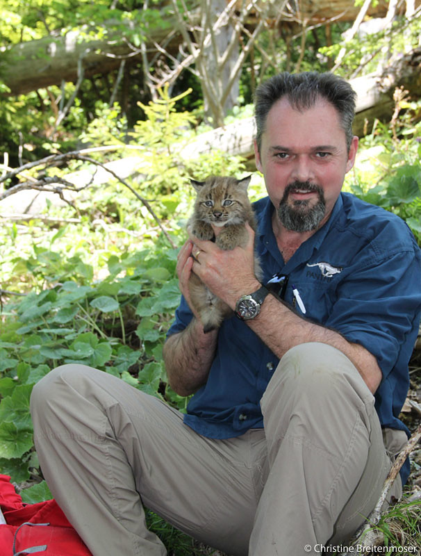 Panthera President, Dr. Luke Hunter, with a 3.5 week old lynx kitten