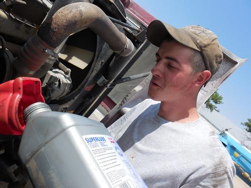 Eric putting oil in the semi