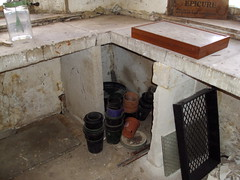 Original convict built stone slabs in laundry room from 1820s at Shene House Tasmania. Plastic pots are more recent.