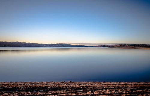 longexposure morning blue sky sunlight lake beach water sunrise landscape sand day sweden sunny swedish clear shore greyfilter örby sjuhärad markskommun öresjön hanatorp