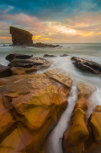 uk blue sea england sky orange seascape clouds sunrise garden landscape rocks waves unitedkingdom wideangle pebbles northumberland charleys sigma1020mm ndfilter seatonsluice nikond5000 koodndgrads