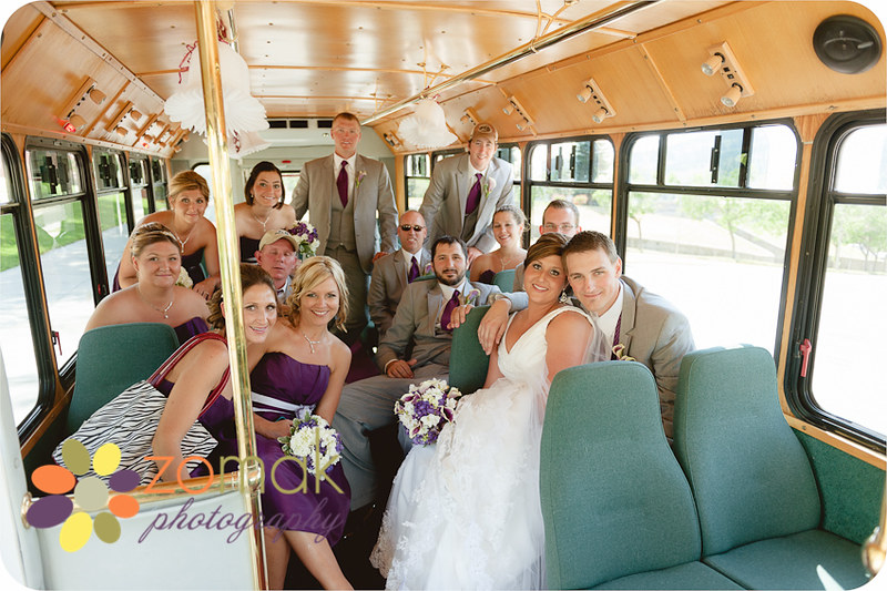 Wedding party rides the trolley from their cathedral wedding to reception location in helena