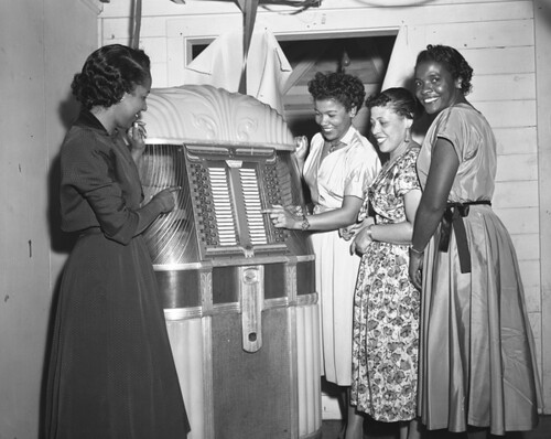 Women at the jukebox during a New Year's Eve party in Tallahassee, Florida