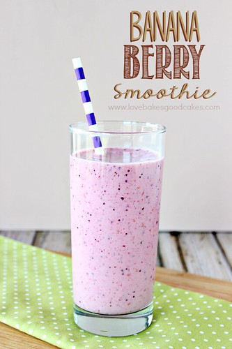 Banana Berry Smoothie in glass with straw.