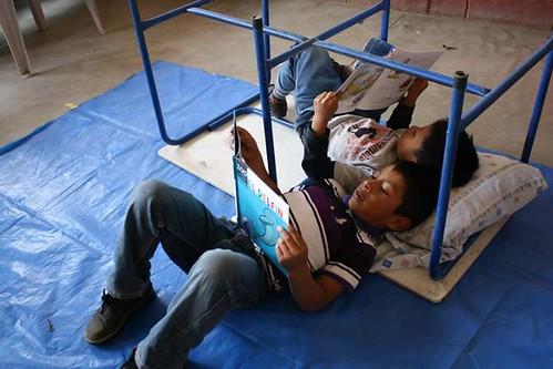 Boys reading at El Caman