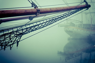 Atmospheric fog along the quay at Kampen, The Netherlands.